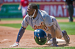 16 March 2014: Detroit Tigers outfielder Rajai Davis slides safely into third during a Spring Training Game against the Washington Nationals at Space Coast Stadium in Viera, Florida. The Tigers edged out the Nationals 2-1 in Grapefruit League play. Mandatory Credit: Ed Wolfstein Photo *** RAW (NEF) Image File Available ***