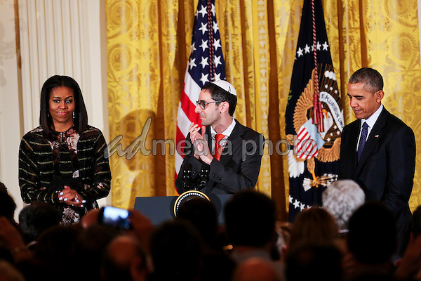 Rabbi Steven Exler speaks while United States President Barack Obama and First Lady Michelle Obama listen during a Hanukkah reception in the East Room of the White House, December 14, 2016, Washington, DC. Photo Credit: Aude Guerrucci/CNP/AdMedia