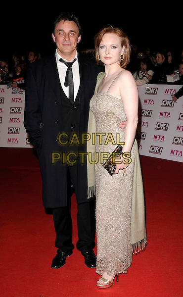 GUESTS.Arriving at the National Television Awards held at the Royal Albert Hall, London, England..October 29th, 2008 .NTA red carpet arrivals full length black suit beige dress clutch bag .CAP/CAN.©Can Nguyen/Capital Pictures.