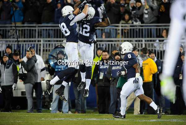 STATE COLLEGE, PA - NOVEMBER 26:  Penn State WR Chris Godwin (12) celebrates by chest bumping mid-air with with TE Mike Gesicki (88) after catching a long touchdown pass during the second half. The Penn State Nittany Lions defeated the Michigan State Spartans 45-12 to win the Big Ten East Division on November 26, 2016 at Beaver Stadium in State College, PA. (Photo by Randy Litzinger/Icon Sportswire)