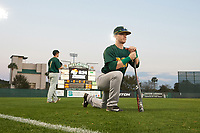 Siena Saints Dan Lowndes (8) stretches in the outfield before a game against the Stetson Hatters on February 23, 2016 at Melching Field at Conrad Park in DeLand, Florida.  Stetson defeated Siena 5-3.  (Mike Janes/Four Seam Images)