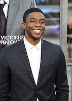 Chadwick Boseman at the Los Angeles premiere of his movie &quot;Draft Day&quot; at the Regency Village Theatre, Westwood.<br /> April 7, 2014  Los Angeles, CA<br /> Picture: Paul Smith / Featureflash