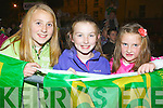 Maeve Sheahan, Úna McGeeven and Jade Costello Killorglin get their flags ready to wave at the Kerry team homecoming in Killorglin on Monday evening.