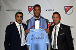 15 January 2015: Khiry Shelton (Oregon State) was selected second overall by New York City FC. With technical director Claudio Reyna (left) and head coach Jason Kreis (right). The 2015 MLS SuperDraft was held at the Pennsylvania Convention Center in Philadelphia, Pennsylvania.