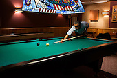 United States President Barack Obama plays a game of pool in the Holly Cabin following the conclusion of the G8 Summit at Camp David, Maryland, May 19, 2012. .Mandatory Credit: Pete Souza - White House via CNP