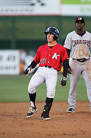 Daniel Mendick (22) of the Kannapolis Intimidators stops as he rounds second base after hitting a double against the Hickory Crawdads at Kannapolis Intimidators Stadium on April 7, 2016 in Kannapolis, North Carolina.  The Crawdads defeated the Intimidators 5-1.  (Brian Westerholt/Four Seam Images)