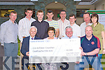 Kilcummin GAA club presents a cheque of EUR40,000 to Eileen and Con Counihan which they won in their Ra?th Chairn draw front l-r: Padraic MacDonncha, Eileen and Con Counihan, Shane O'Callaghan Chairman. Back row: Colin, Brendan, Noel, Tim Counihan, Neilus McCarthy, John Counihan, Tim Casey and Marie Devane Secretary