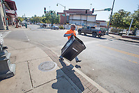 NWA Democrat-Gazette/J.T. WAMPLER Doug Brooks of Fayetteville empties trash cans Sunday Sept. 27, 2015 on Dickson St. in Fayetteville. Brooks was one of a troop of volunteers from Fayetteville Sequoyah Kiwanis club that cleans the venues from Bikes, Blues and BBQ for a club fundraiser. Next year's dates for the festival are Sept. 21-24, 2016.