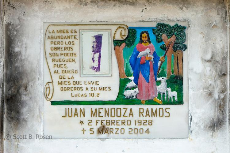 Colorful gravestones in a cemetery in San Juan La Laguna, Lake Atitlan, Guatemala