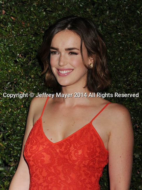BEVERLY HILLS, CA- OCTOBER 02: Actress Elizabeth Henstridge  arrives at the Michael Kors Hosts Launch Of Claiborne Swanson Frank's 'Young Hollywood' Portrait Book at a private residence on October 2, 2014 in Beverly Hills, California.