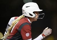 NWA Democrat-Gazette/ANDY SHUPE<br /> Arkansas designated hitter Danielle Gibson heads to first against Southeast Missouri Thursday, Feb. 21, 2019, during the fifth inning at Bogle Park on the university campus in Fayetteville.