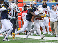 Morgantown, WV - November 18, 2017: Texas Longhorns running back Kyle Porter (21) gets tackled by West Virginia Mountaineers safety Dravon Askew-Henry (6) during game between Texas and WVU at  Mountaineer Field at Milan Puskar Stadium in Morgantown, WV.  (Photo by Elliott Brown/Media Images International)