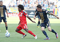Sebastien Le Toux #9 of the Philadelphia Union loses the ball to Julian de Guzman #6 of Toronto FC during an MLS match at PPL stadium in Chester, PA. on July 17 2010. Union won 2-1 with a last minute penalty kick goal.