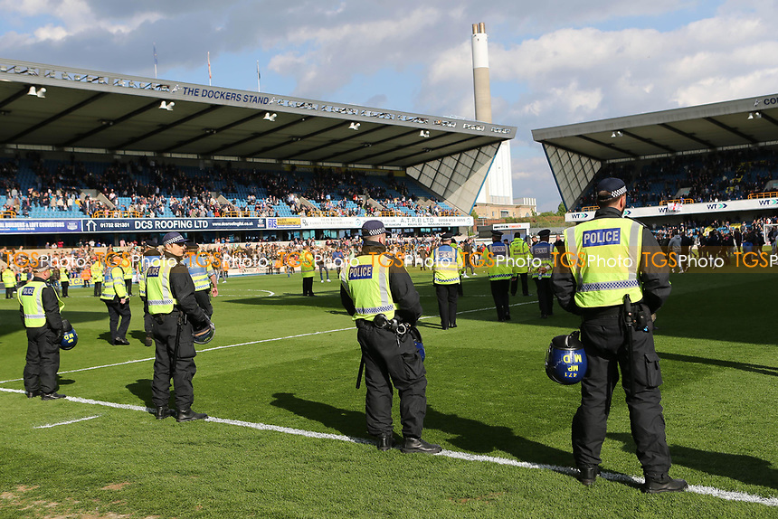 Police Officers look on as Millwall fans gradually return to their seats after running onto the pitch at the final whistle during Millwall vs Oxford United, Sky Bet EFL League 1 Football at The Den on 22nd April 2017