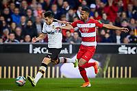 9th November 2019; Mestalla, Valencia, Spain; La Liga Football,Valencia versus Granada; Maxi Gomez of Valencia CF is challenged by Yangel Herrera of Granada - Editorial Use