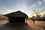 A girl sweeps her family's compound as the sun rises in the Southern Sudan village of Kupera. Families here returned from refuge in Uganda in 2006 following the 2005 Comprehensive Peace Agreement between the north and south. NOTE: In July 2011, Southern Sudan became the independent country of South Sudan
