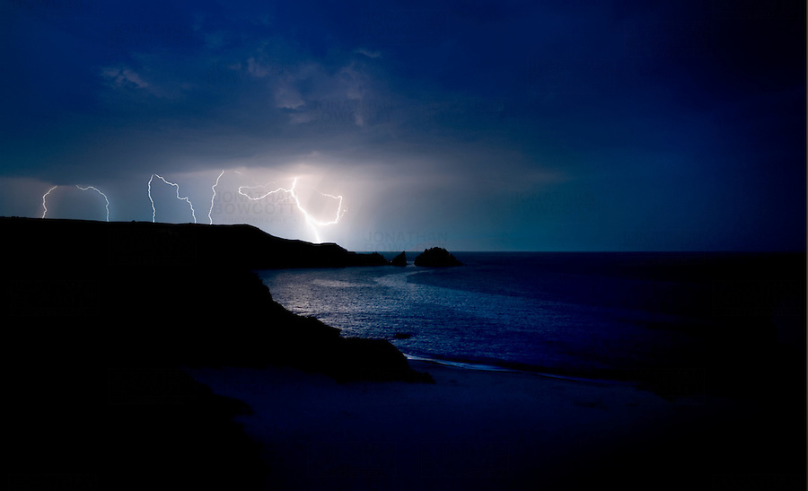 An electric storm over Mother Iveys Bay on the North Cornish coast, UK. Image taken in July. Mother Iveys Bay is approx 5 miles south of Padstow the Cornish fishing village made popular by the Rick Stein 'empire'