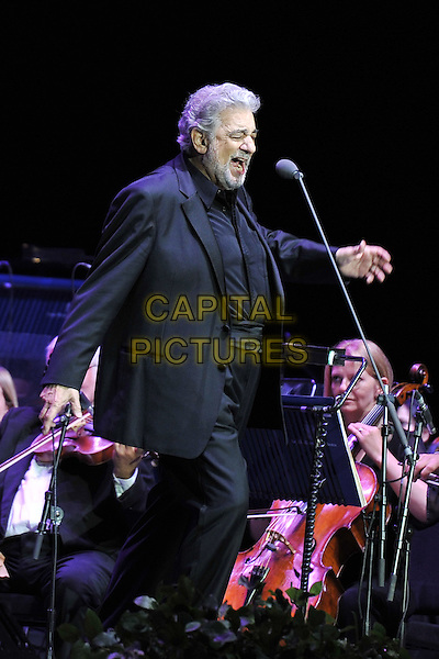 Placido Domingo .performing on stage at the O2 Arena, London, UK, July 29th, 2011..music opera singer concert live half length grey gray suit  microphone singing beard facial hair hand side .CAP/MAR.© Martin Harris/Capital Pictures.