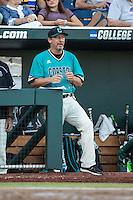 Gary Gilmore #14 of the Coastal Carolina Chanticleers looks on during a College World Series Finals game between the Coastal Carolina Chanticleers and Arizona Wildcats at TD Ameritrade Park on June 27, 2016 in Omaha, Nebraska. (Brace Hemmelgarn/Four Seam Images)