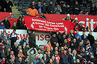 Liverpool supporters hold a banner in tribute to the 96 who died in Hillsborough during the Barclays Premier League match between Swansea City and Liverpool at the Liberty Stadium, Swansea on Sunday May 1st 2016
