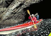 Ocean kayaking through sea caves near Mendocino California.  CD scan from 35mm film.  © John Birchard