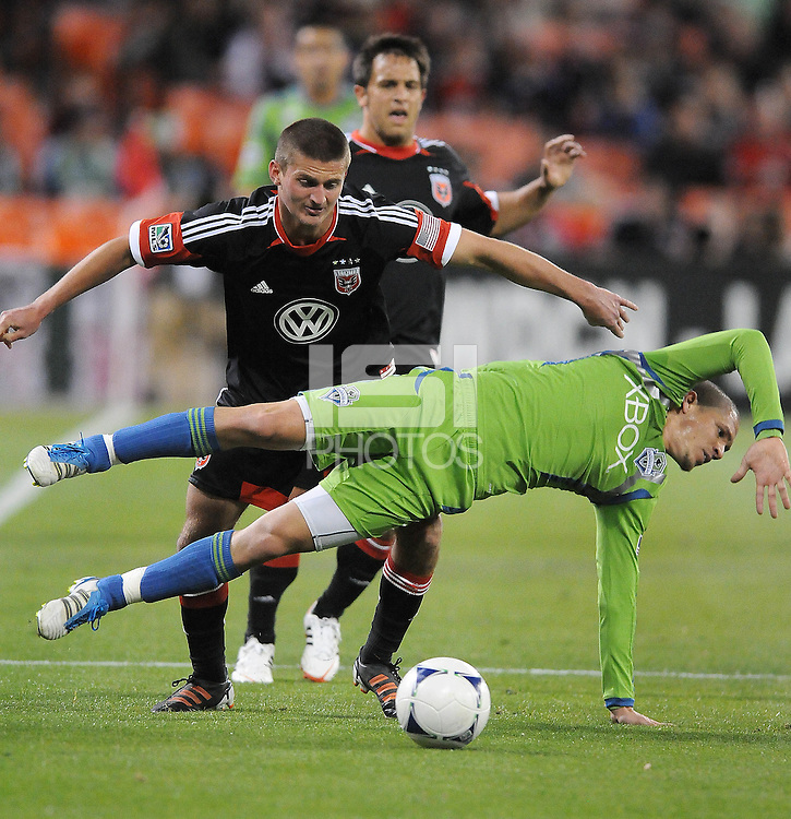 Seattle Sounder midfielder Osvaldo Alonso (6) gets fouled by D.C. United midfielder Perry Kitchen (23)  D.C. United tied The Seattle Sounders 0-0 at RFK Stadium, Saturday April 7 , 2012.