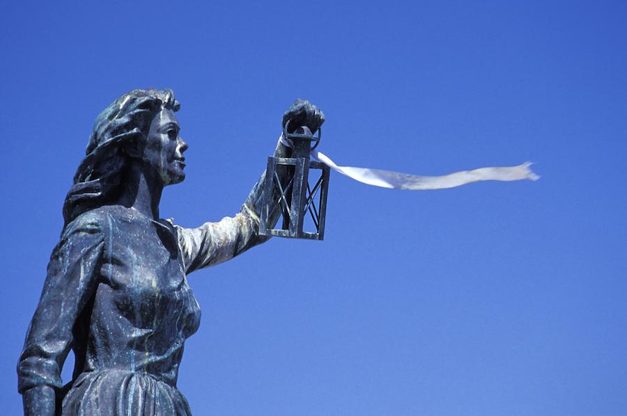 Statue of woman holding lantern and ribbon, Anacortes, Fidalgo Island, Washington