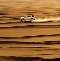 4x4 driving in the Sahara Desert at sunset, Libya