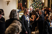 Robert Plant (C) of the band Led Zeppelin attend the Kennedy Center Honors reception at the White House on December 2, 2012 in Washington, DC. The Kennedy Center Honors recognized seven individuals - Buddy Guy, Dustin Hoffman, David Letterman, Natalia Makarova, John Paul Jones, Jimmy Page, and Robert Plant - for their lifetime contributions to American culture through the performing arts. .Credit: Brendan Hoffman / Pool via CNP