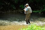 Trout fisherman tying fly in Penns Creek.