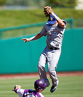 Koby Kraemer (5) of the Indiana State Sycamores leaps over a base runner to catch a high thrown ball during a game against the Evansville Purple Aces in the 2012 Missouri Valley Conference Championship Tournament at Hammons Field on May 23, 2012 in Springfield, Missouri. (David Welker/Four Seam Images)