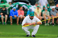 Caddy Craig Connolly on the 18th green during the 2nd round at the The Masters , Augusta National, Augusta, Georgia, USA. 12/04/2019.<br /> Picture Fran Caffrey / Golffile.ie<br /> <br /> All photo usage must carry mandatory copyright credit (© Golffile | Fran Caffrey)