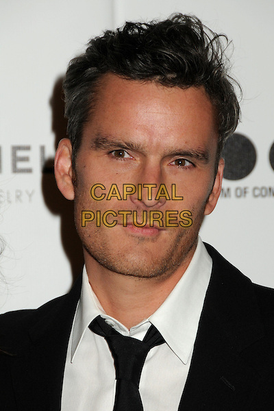 "BALTHAZAR GETTY .attending MOCA's Annual Gala, ""The Artist's Museum Happening"", Sponsored by Chanel Fine Jewelry, held at MOCA Grand Avenue (Museum Of Contemporary Art) in Los Angeles, California, USA, November 13th 2010. .portrait headshot tie black white shirt .CAP/ADM/BP.©Byron Purvis/AdMedia/Capital Pictures."