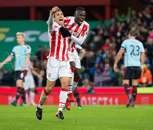 03.12.2016. Bet365 Stadium, Stoke, England. Premier League Football. Stoke City versus Burnley. Stoke City defender Marc Muniesa shouts in celebration after scoring in the 35th minute (2-0) and is joined by Stoke City striker Mame Biram Diouf.