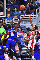 Ish Smith of the Wizards shoots against Kyle O'Quinn of the Knicks.  New York defeated Washington 115-104 during a NBA preseason game at the Verizon Center in Washington, D.C. on Friday, October 9, 2015.  Alan P. Santos/DC Sports Box