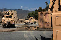 A view of three MRAP is parked out the front of the Police station in asadabad