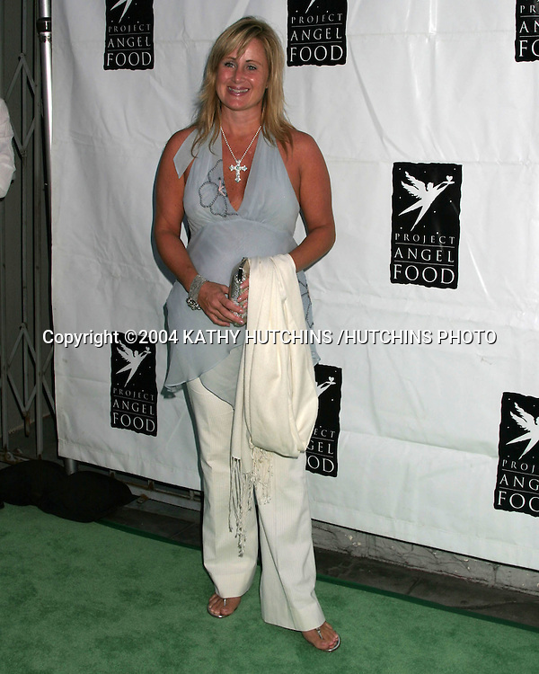 ©2004 KATHY HUTCHINS /HUTCHINS PHOTO.PROJECT ANGEL FOOD GALA IN HONOR OF SHARON STONE.LOS ANGELES, CA.AUGUST 21, 2004..KELLY STONE