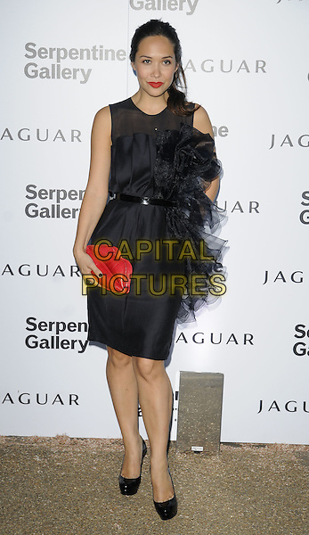MYLEENE KLASS .At the Serpentine Gallery Summer Party, Serpentine Gallery, Hyde Park, London, England, UK, July 8th 2010..full length red clutch bag lips mouth Lulu guinness novelty shaped shape black sheer sleeveless dress waist belt chiffon silk ruffle shoes patent platform shift .CAP/CAN.©Can Nguyen/Capital Pictures.