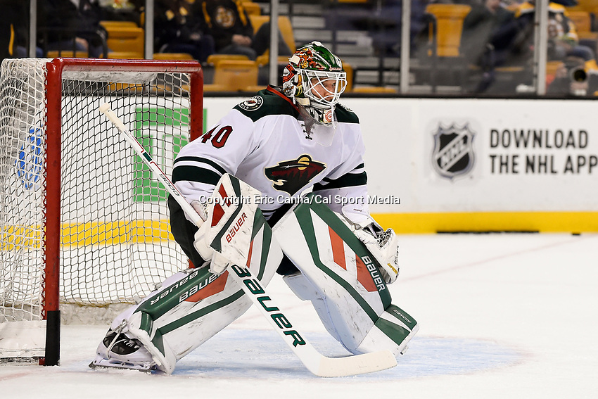 Thursday, November 19, 2015: Minnesota Wild goalie Devan Dubnyk (40) warms up before the start of the National Hockey League game between the Minnesota Wild and the Boston Bruins held at TD Garden, in Boston, Massachusetts. The Bruins defeat the Wild 4-2. Eric Canha/CSM