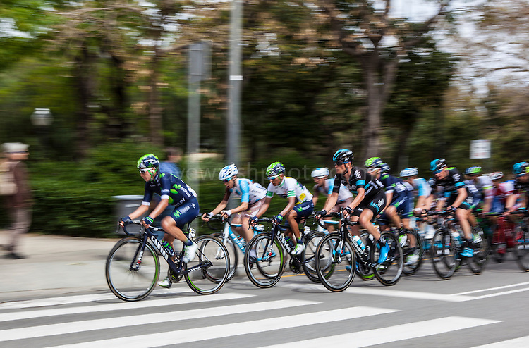 The peloton climbs Montjuic, Barcelona, on the last stage of the Volta Catalunya 2016 cycling race. The leader, Nairo Quintana (3rd from left) successfully defended his jersey from Alberto Contador and Dan Martin.<br /> <br /> El pelot&oacute;n sube Montjuic, Barcelona, en la &uacute;ltima etapa de la carrera ciclista Volta Catalunya 2016. El l&iacute;der, Nairo Quintana, defendiendo con &eacute;xito su maillot de Alberto Contador y Dan Martin.<br /> <br /> El gran grup puja Montju&iuml;c, Barcelona, en l'&uacute;ltima etapa de la cursa ciclista Volta Catalunya 2016. El l&iacute;der, Nairo Quintana, defensant amb &egrave;xit el seu mallot d'Alberto Contador i Dan Martin.