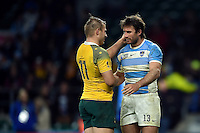 Drew Mitchell of Australia commiserates with Marcelo Bosch of Argentina after the match. Rugby World Cup Semi Final between Argentina v Australia on October 25, 2015 at Twickenham Stadium in London, England. Photo by: Patrick Khachfe / Onside Images