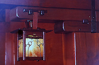 Greene & Greene:  Gamble House, Pasadena CA. , 1908.  Detail of inglenook sconce and woodwork. (Photo Jan. 1987)