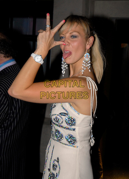 LIZ FULLER.Fashion Is Art VIP Launch at Carbon.11th July 2007 , LondonEngland.half length tongue out funny face fingers hand.Ref:CAP/SW.©Stephen Walters/Capital Pictures.