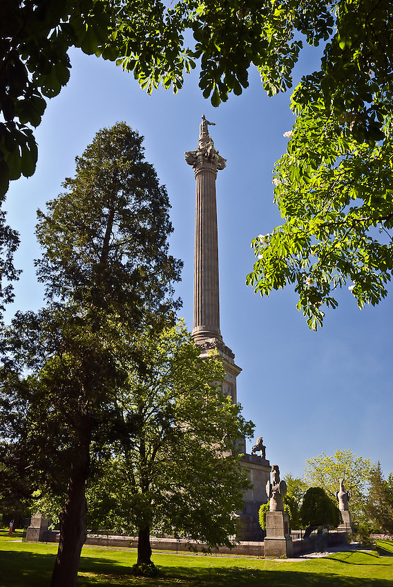 SUBJECT: Monument commemoratin Sir Isaac Brock and his victory over invading Americans at Queenston Heights, Ontario in the War of 1812  IMAGE: The monument, with Brock at the top, is seen through the trees, towering above Queenston Heights overlooking the Niagara River
