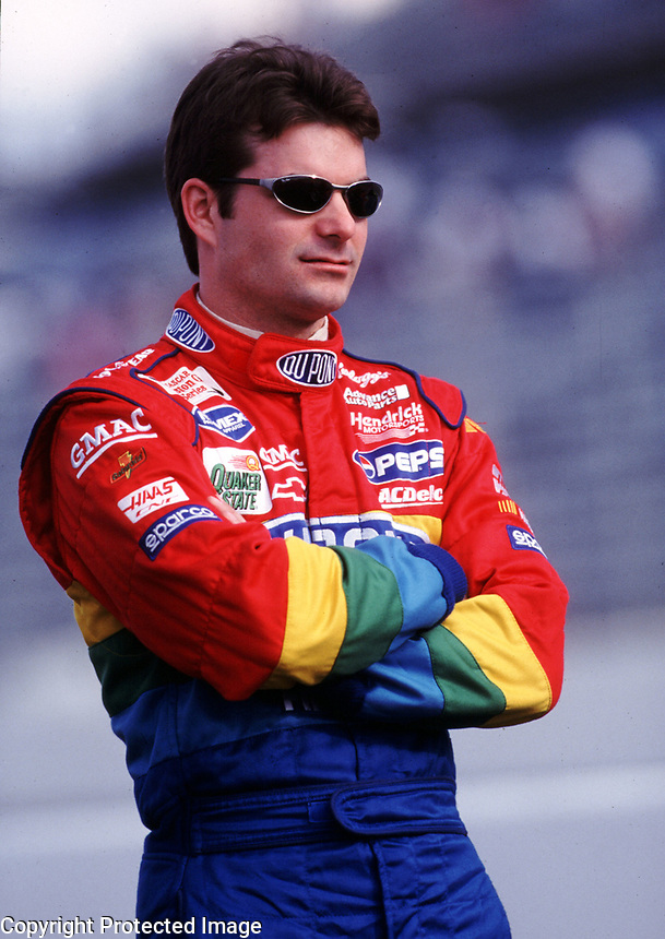 NASCAR driver Jeff Gordon waits to qualify at Darlington, SC on Friday, 3/17/00.  (Photo by Brian Cleary)