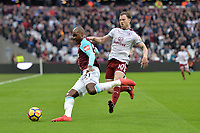 Angelo Ogbonna of West Ham and Ashley Barnes of Burnley  during West Ham United vs Burnley, Premier League Football at The London Stadium on 10th March 2018