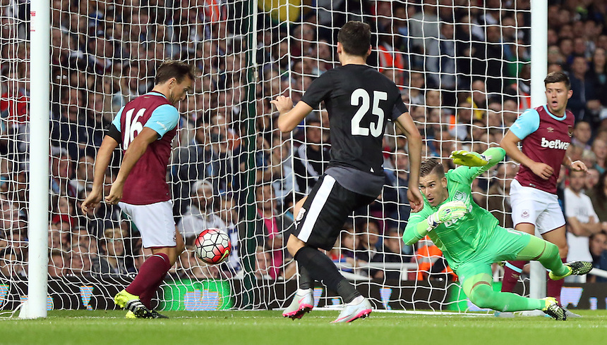 West Ham United's Mark Noble save of the line from FC Astra Giurgiu Valerica Gaman<br /> <br /> Photographer Kieran Galvin/CameraSport<br /> <br /> Football - UEFA Europa League Qualifying Third Round First Leg - West Ham United v Astra Giurgiu - Thursday 30 July 2015 - Boleyn Ground - London<br /> <br /> &copy; CameraSport - 43 Linden Ave. Countesthorpe. Leicester. England. LE8 5PG - Tel: +44 (0) 116 277 4147 - admin@camerasport.com - www.camerasport.com