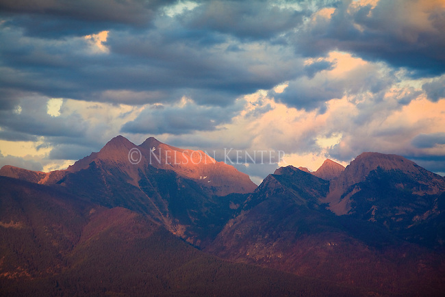 The late evening sun spotlights the Mission Mountains