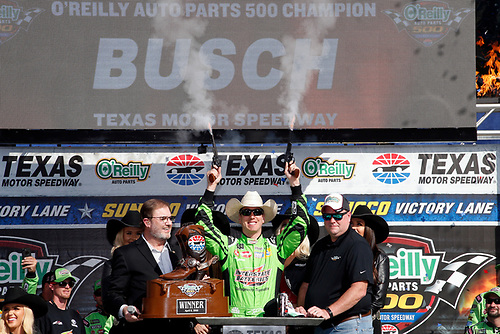 #18: Kyle Busch, Joe Gibbs Racing, Toyota Camry Interstate Batteries celebrates his victory