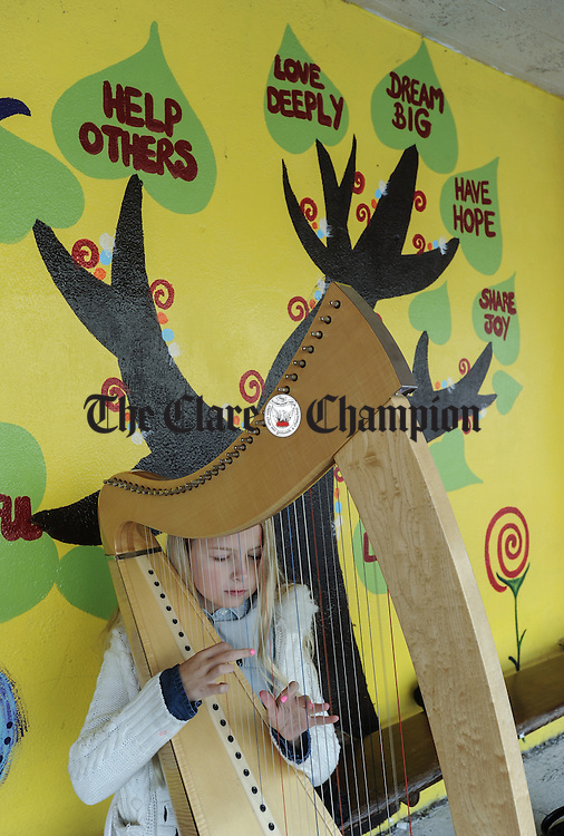Erin Hooker of New York practicing on her harp before competing at Fleadh Cheoil na hEireann in Ennis. Photograph by John Kelly.